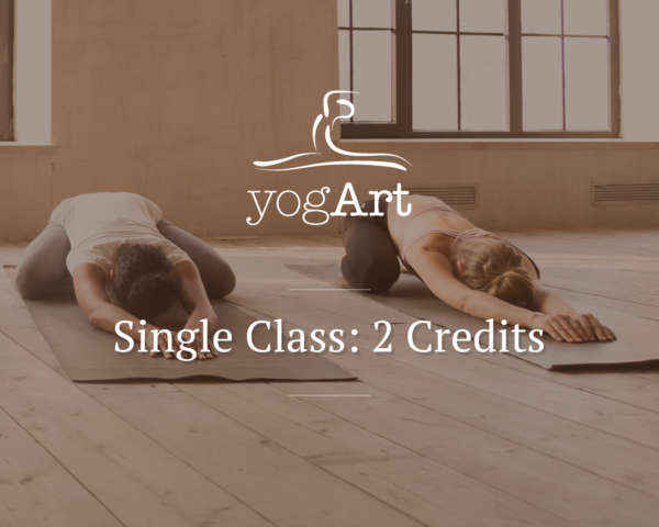 a woman in a white T-shirt and leggings, and a woman in a pink sports bra and leggings doing the child's pose in a yoga studio with wooden flooring and large windows