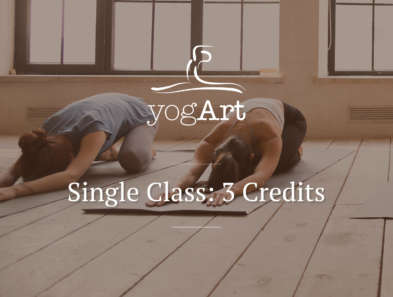 a woman in a blue T-shirt and leggings, and a woman in a grey sports bra doing the child's pose on a grey yoga mat in a yoga studio with wooden flooring